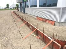 Construction with sidewalk forms