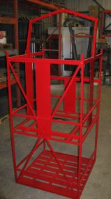 Cage for concrete bucket with storage below
