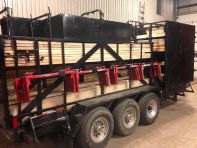 Trailer for scaffold brackets, beam and footing cage.